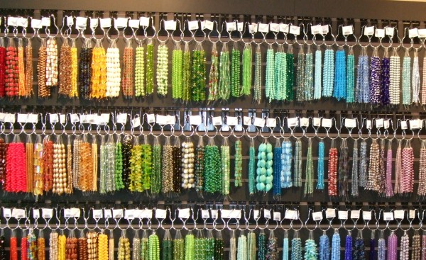Strands of gem stones and beads come in a rainbow of hues.