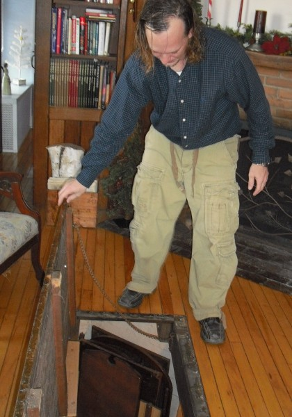 This trap door in the floor was another way to whisk slaves to safety. The walk-out basement once led to a barn.