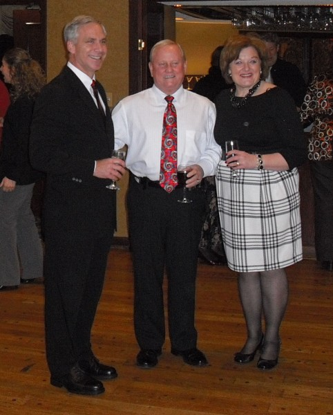 Denis Hanwell, Jim Bigam, and Janie Parish celebrate the beginning of a new administration at Rustic Hills Country Club.